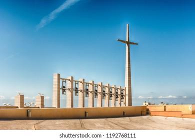 Cross and bells in the Sanctuary of Saint Pio of Pietrelcina, Catholic shrine in San Giovanni Rotondo, Italy