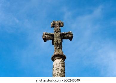 A cross and blue sky