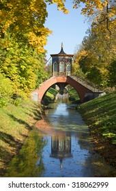 Cross the bridge golden autumn. Alexander Park of Tsarskoye Selo, St. Petersburg