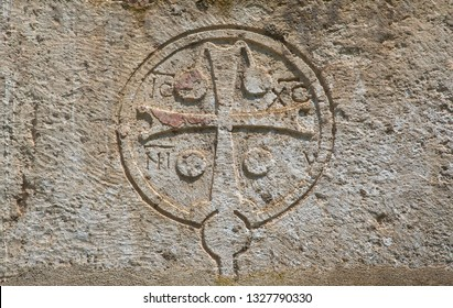 Cross carved in stone on wall at temple Canaanite in new athos, abkhazia