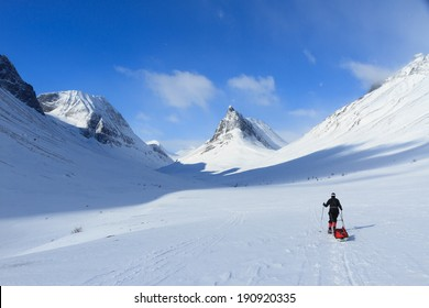 Cross country skier with pulka in the mountains of Lapland, Sweden.