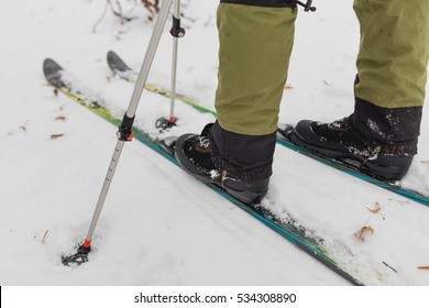 Cross country skiing in winter woods. Close up of shoes and modern plastic skiis.