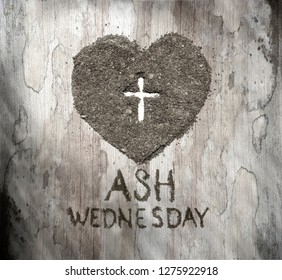 Cross or crucifix in heart symbol made of ash, sand or dust as Jesus Christ christian passion or chrism,  Ash Wednesday concept