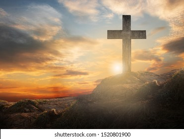 cross The crucifixion of the crucifix on a hilltop with a sunset background