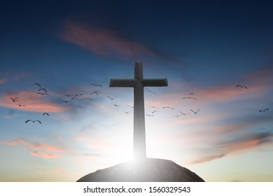 cross crucifixion jesus christ has a sunset background