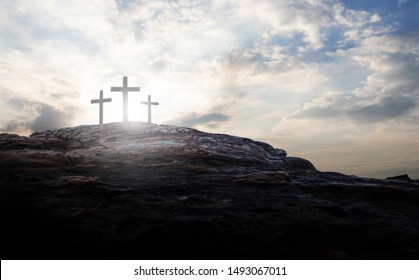 cross crucifixion jesus christ on the mountain at sunset abstract concept