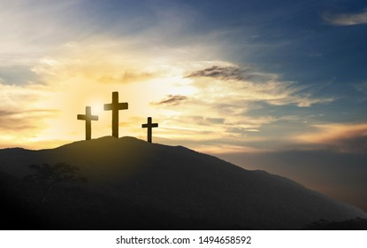 cross crucifixion at the summit of the hill at sunset Jesus Christ, abstract concept