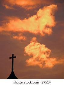cross in the dawn sky