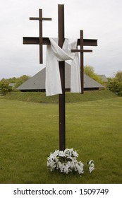 A cross is decorated to celebrate Easter Sunday and the resurrection of Christ