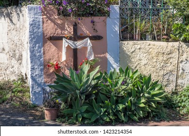 Cross decorated on a wall next to a road outside the city of La Laguna, Tenerife, Canary Islands