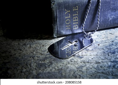 Cross dog tag necklace and The Bible