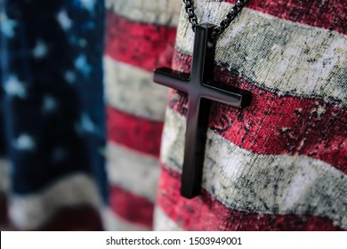 A cross draped over the American flag.