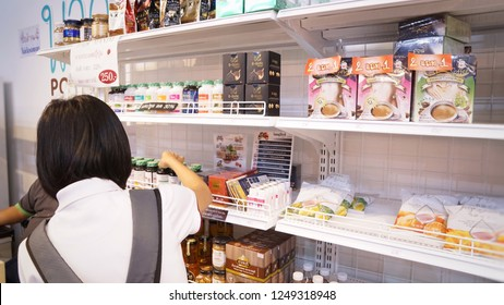 Red​ Cross Fair, Lumpini Park, Bangkok (30 Nov 18) - Thai woman is choosing supplementary food products made from Thai herbs put on shelves of small store at the fair