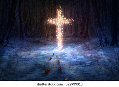 A cross in the forest lit up with Christmas lights