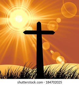 cross in a grass and  sun sky background