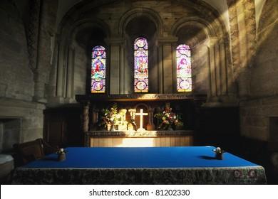 Cross Illuminated At The Altar Of A Church