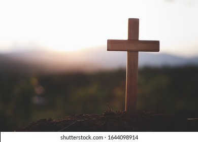 Cross of jesus The background of the setting sun is about to turn down. Christian religious concepts Crucifixion of faith and faith in god.