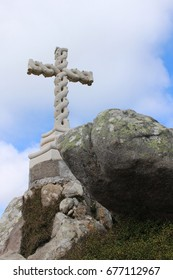 Cross and a large boulder on the observation deck of the Cruz Alta in Sintra. Portugal