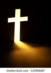Cross with light shafts. Faith symbol.