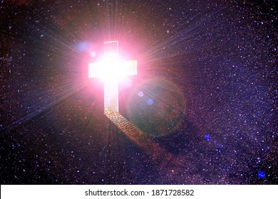 Cross with light shafts in space. Faith symbol.