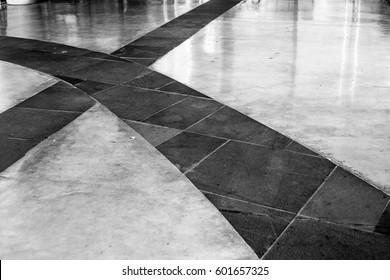 cross line on the walk way shiny stone slab