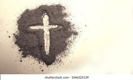 Cross made in ash on clean background, cross symbol of Christianity is drawn in the ash for ash Wednesday.
