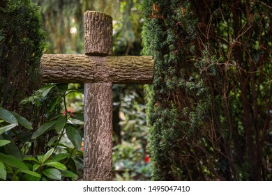 Cross made of logs in a cemetery