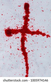 A cross made of red blood on a white snow in Finland.