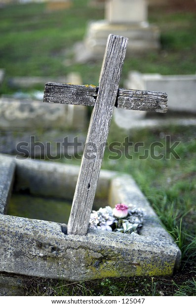 Cross marking grave of child in Children's section of cemetery