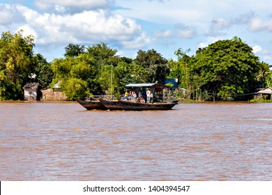 Cross the Mekong river by ferry from Vietnam to Cambodia