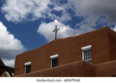 Cross on an adobe church