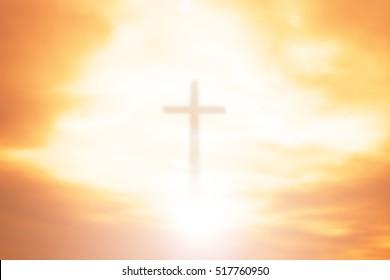 cross on blurry sunset background