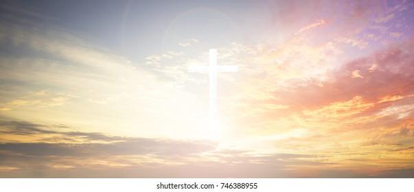 cross on blurry sunset background,
