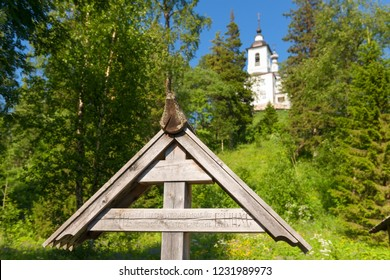 The cross on the burial place of the Holy Martyr Peter Zverev Archbishop of Voronezh in the Golgotha-Crucifix skete at Mount Calvary on Anzersky Island, Solovki Islands, Arkhangelsk Region, Russia