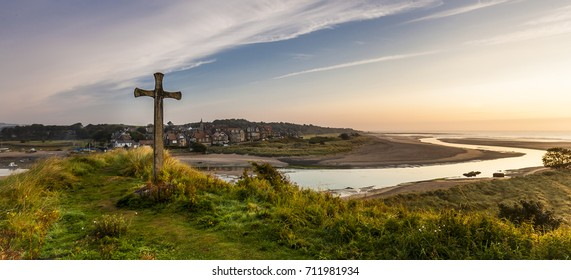 The Cross on Church Hill, Alnmouth, Northumberland, England, UK. At sunrise/dawn. The hill is the site of the ancient parish church of St Waleric. Long since destroyed.