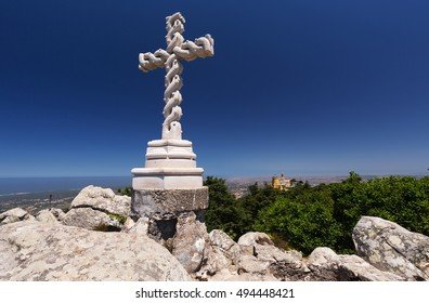 A Cross on the hill top of the Pena National Park and Palace, Sintra, Portugal