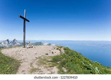 Cross on le Grammont mountain and lake Geneva on the background (Switzerland)