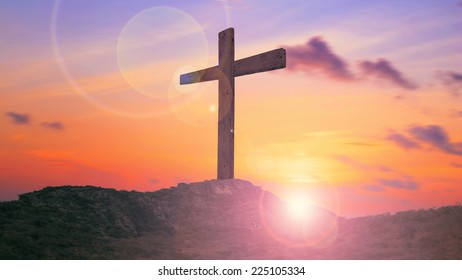 The cross on the mountain golgotha representing the day of christs crucifixion in a sunset.