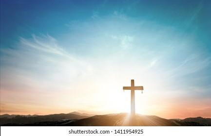The cross on mountain sunset background