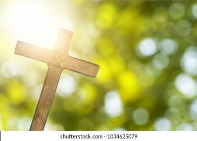 Cross on nature green background