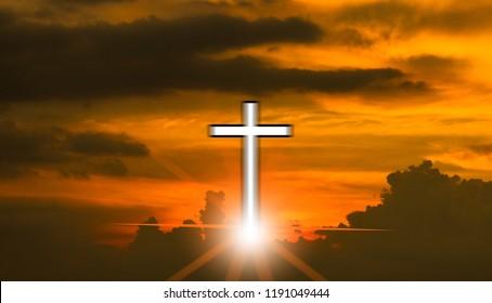 Cross on the orange sky before sunset.