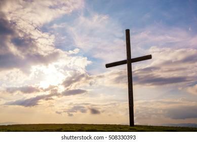 Cross on sky sunset background