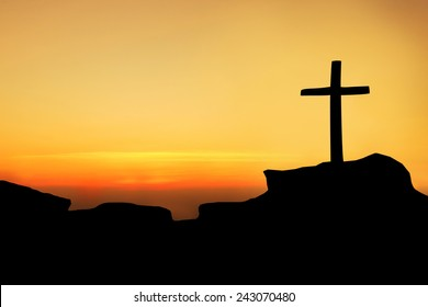 The cross on top a mountain.