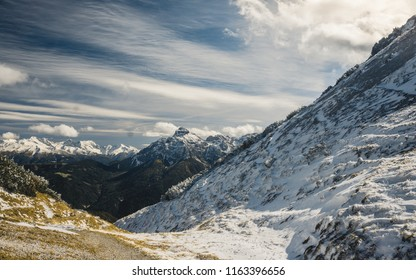 The cross on top of the mountain Nockspitze in the austrian alps. Innsbruck and the Alps are seen from the Mount Seegrube. 2017
