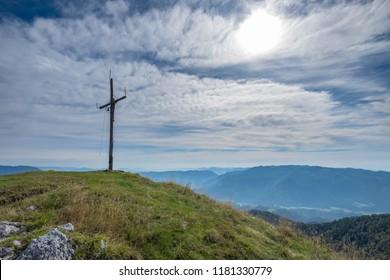 Cross on the top of mountain Veliki Rogatec in Kamnik-Savinja Alps, Slovenia