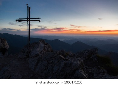 Cross on the top of mountains during sunset in epic scenery, Slovakia Big Rozsutec
