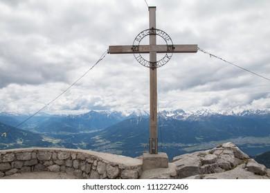 Cross on top peak of Nordkette mountain, Tyrol, Innsbruck, Austria.
