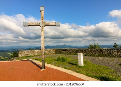 Cross on the viewing platform at the Hochwaldbaude with landmark in the Zittau Mountains