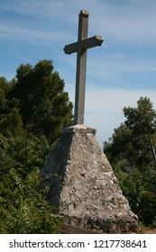cross on the viewpoint in Veli Losinj, island Losinj, Croatia