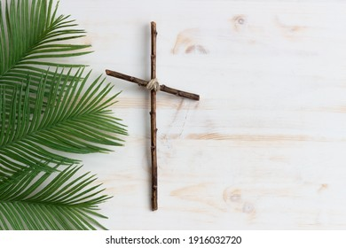 cross and palms on white wood background with copy space
